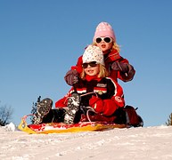 girls_enjoying_winter_play_outdoors