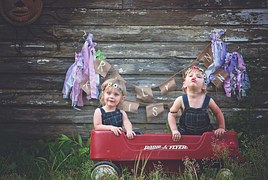 Connecticut_twins_fun_wagon_outside_warm_playing