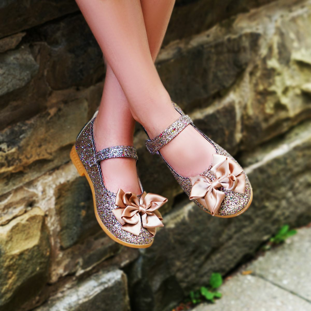 Sparkly copper and gold shoes with a bow