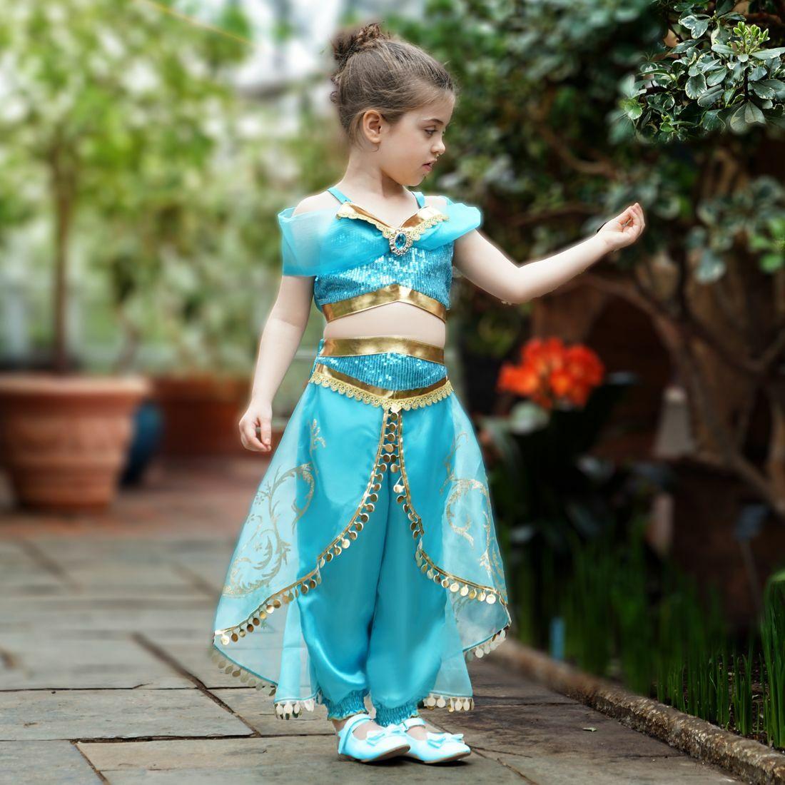 Girl in a two-piece blue Arabian princess costume