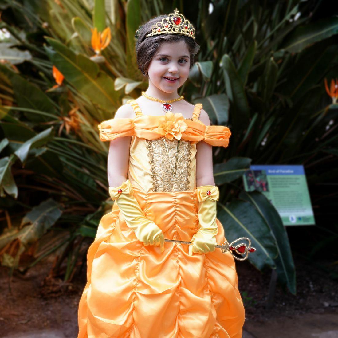 Girl in a tiara wearing a yellow princess dress