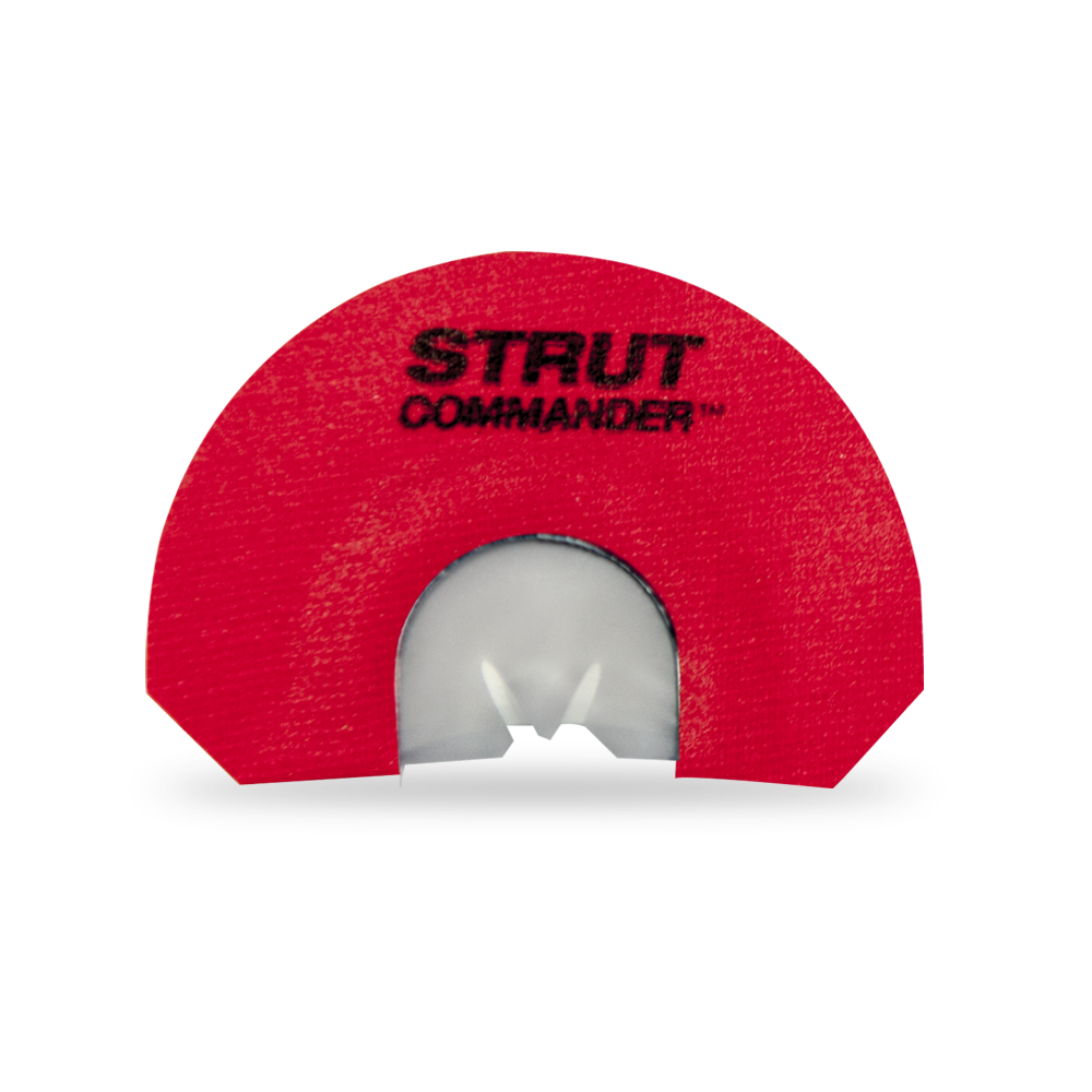 "The Venus Strut Commander mouth / diaphragm call is  a 3 reed,  modified- V cut, call with light rasp and soft to medium volume - made with latex reeds, metal frame and red tape with ""Strut Commander"" screen printed in black."