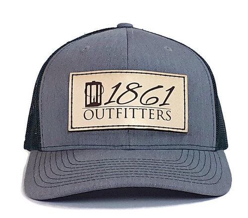Explore America's great historic outdoors in our gray / green mesh trucker hat with natural leather patch. Leather patch is sewn on this premium mesh hat qiving you the lasting quality you have come to know from 1861 Outfitters.