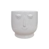 White Ceramic Pot for Plants with a Peaceful Face
