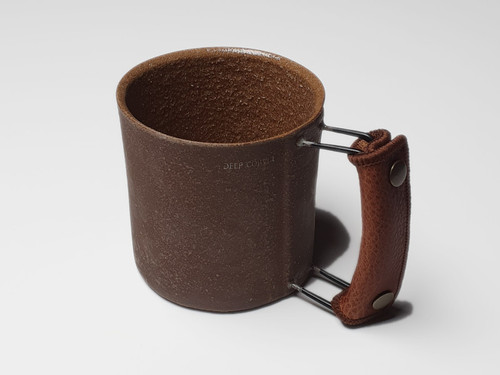 Handmade vintage coffee mug in dark brown colour with metal handle