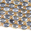 Crystal 12x16mm Opaque Grey Faceted Oval Beads with Golden Foil Edges - 8 inch strand