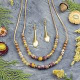 Illuminating Gemstone & Brass Jewelry