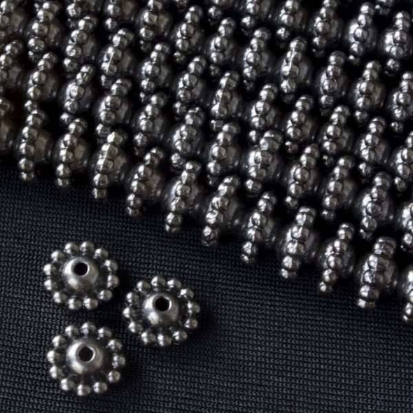 Gun Metal Colored Pewter 5x9mm Smooth Round Beads with Dots Around Center - approx. 8 inch strand - basea0736gm