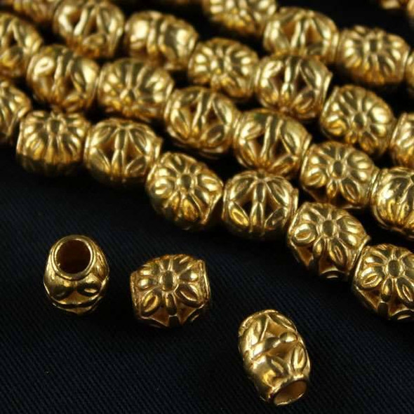 Gold Colored Pewter 8x10mm Barrel Beads with Large Flowers On Each Side - approx. 8 inch strand - basea0855g