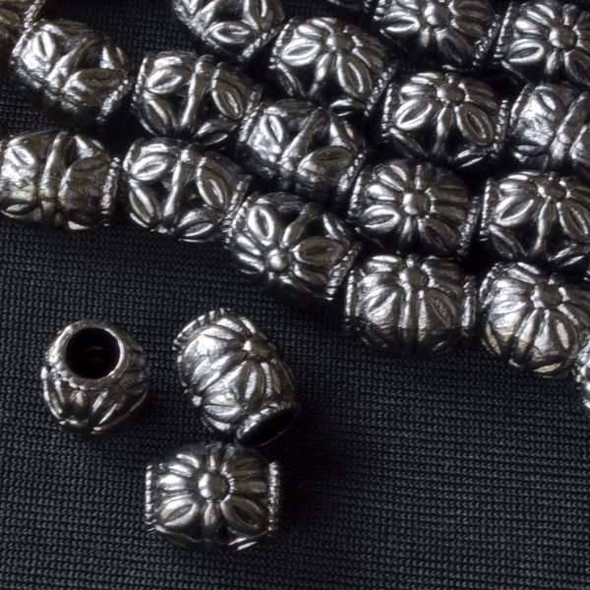 Gun Metal Colored Pewter 8x10mm Barrel Beads with Large Flowers on each side - approx. 8 inch strand - basea0855gm