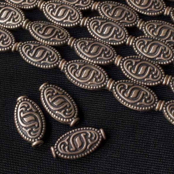 Vintage Copper Colored Pewter 9x17mm Oval Beads with Tribal Mark - approx. 8 inch strand - basea47298vc
