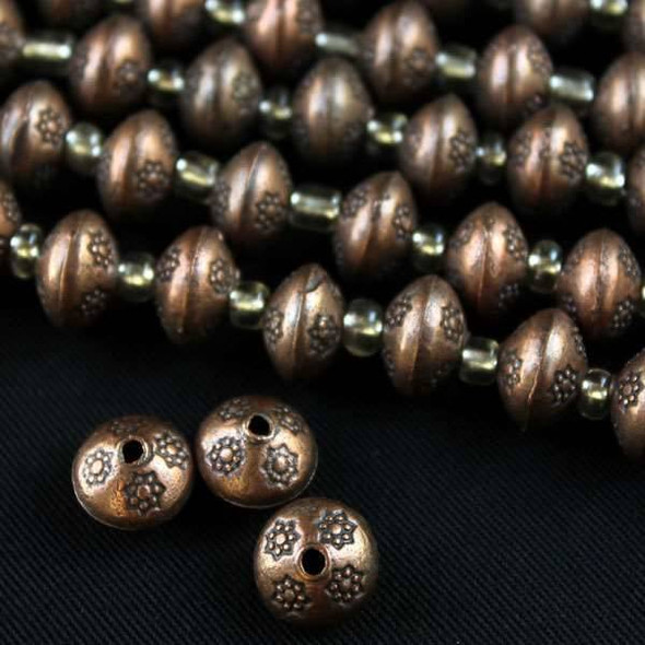 Vintage Copper Colored Pewter 7x10mm Thai Style Beads Smooth with Small Detailed Stars - approx. 8 inch strand - basea5009vc