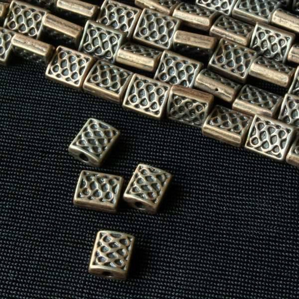 Vintage Copper Colored Pewter 6x12mm Rectangle Beads with Circle Pattern - approx. 8 inch strand - basea5039vc
