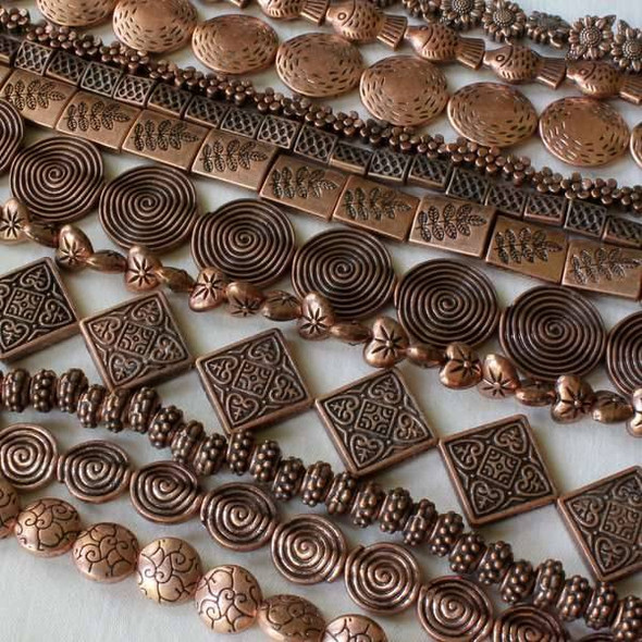 A Bulk Mix of 50 assorted 8 inch strands of Vintage Copper Colored Pewter Beads
