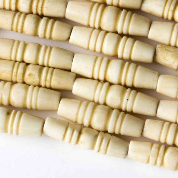 Bone 6-8x23-25mm Natural Grooved Tube with approximately a 2mm Large Hole