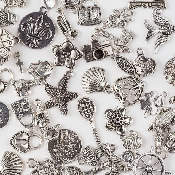 A Loose Mix of 100 Assorted Pewter Charms