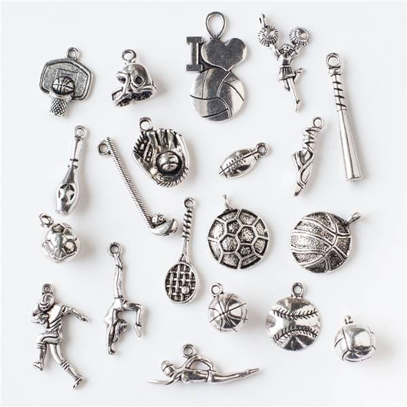 An Assorted Mix of 25 Silver Sports Charms