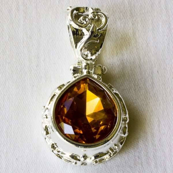 Glass Crystal 25x43mm Topaz Teardrop Pendant with a Silver Base Metal Bail