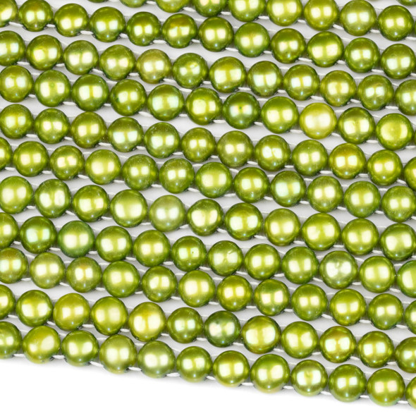 Fresh Water Pearl 7-8mm Chartruese Green Double Drilled Button Beads - 16 inch strand