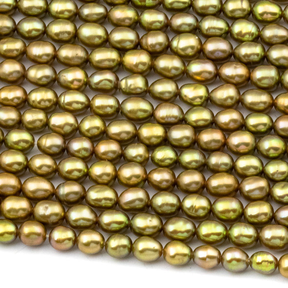 Fresh Water Pearl 4-5x5-6mm Golden Green Rice Beads - 16 inch strand
