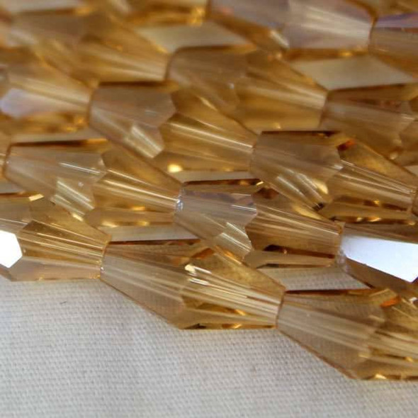 Glass Crystal Faceted 6x12mm Champagne Long Bicone - approx. 8 inch strand