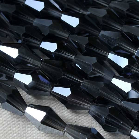 Glass Crystal Faceted 6x12mm Montana Long Bicone - approx. 8 inch strand