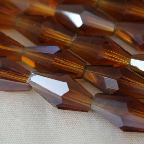 Glass Crystal Faceted 6x12mm Topaz Long Bicone - approx. 8 inch strand