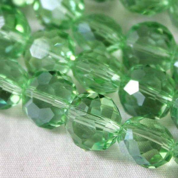 Glass Crystal Faceted 10mm Chrysolite Coin - approx. 8 inch strand