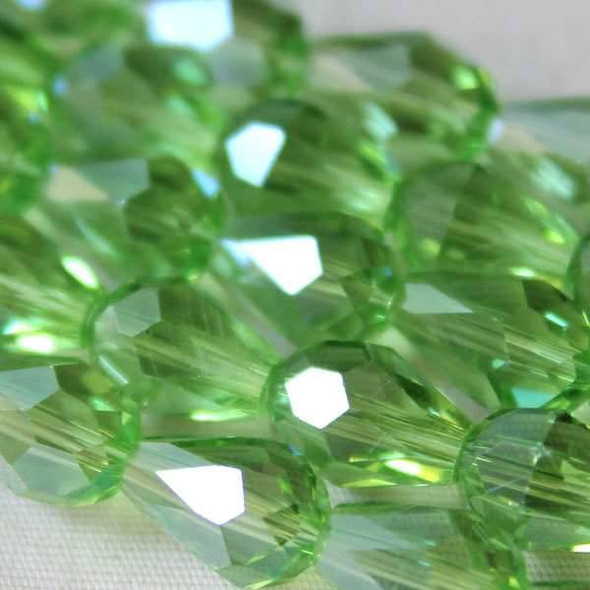 Glass Crystal 6x8mm Chrysolite Rounded Teardrop - approx. 8 inch strand