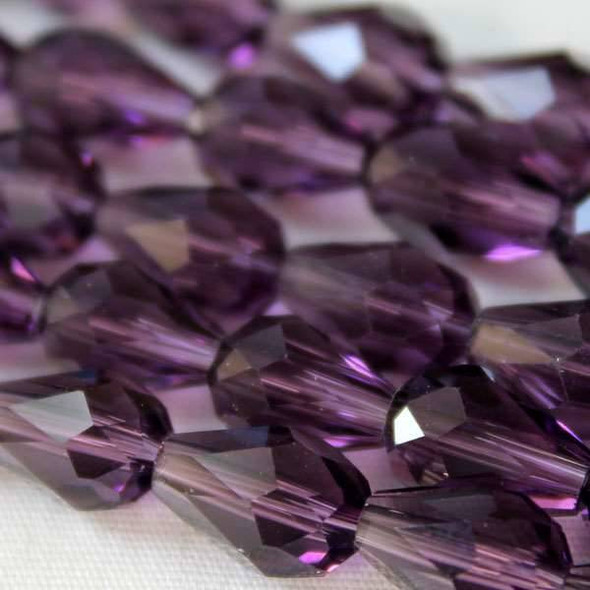 Glass Crystal 6x8mm Medium Amethyst Rounded Teardrop - approx. 8 inch strand