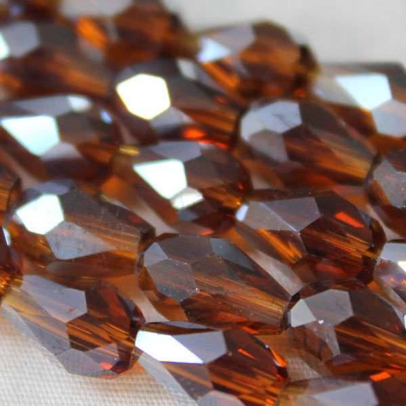 Glass Crystal 8x11mm Topaz Rounded Teardrop - approx. 8 inch strand