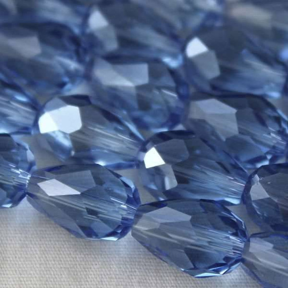 Glass Crystal 8x11mm Medium Sapphire Rounded Teardrop - approx. 8 inch strand