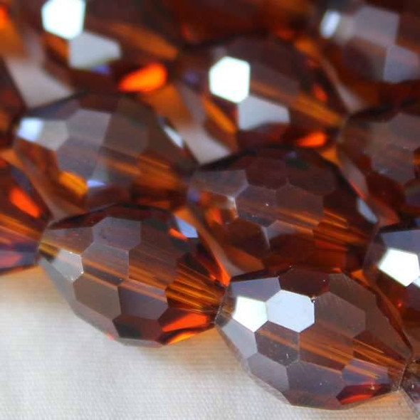 Glass Crystal Faceted 10x13mm Topaz Rice - approx. 8 inch strand