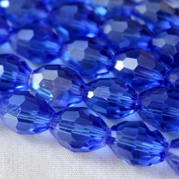 Glass Crystal Faceted 8x10mm Sapphire Rice - 8 Inch Strand