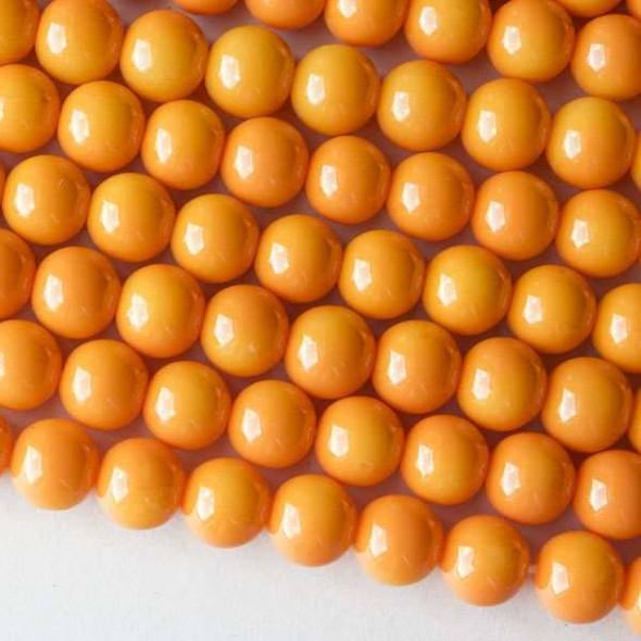 Glass 8mm Light Orange Round - 16 inch strand