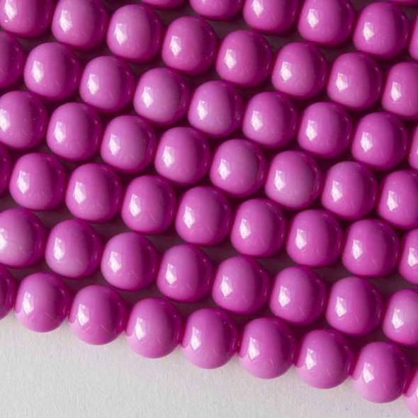 Glass 8mm Princess Pink Round - 16 inch strand