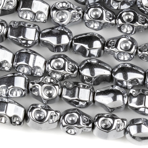 Hematite 8x10mm Plated Silver Skull Beads - approx. 8 inch strand