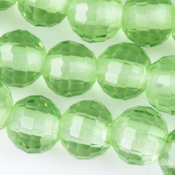 Large Hole Faceted Crystal 10mm Chrysolite Green Rounds with approximately a 2.5mm Drilled Hole - approx. 8 inch strand