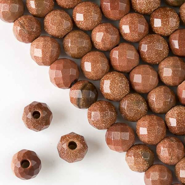 Faceted Large Hole Goldstone 10mm Round with a 2.5mm Drilled Hole - approx. 8 inch strand