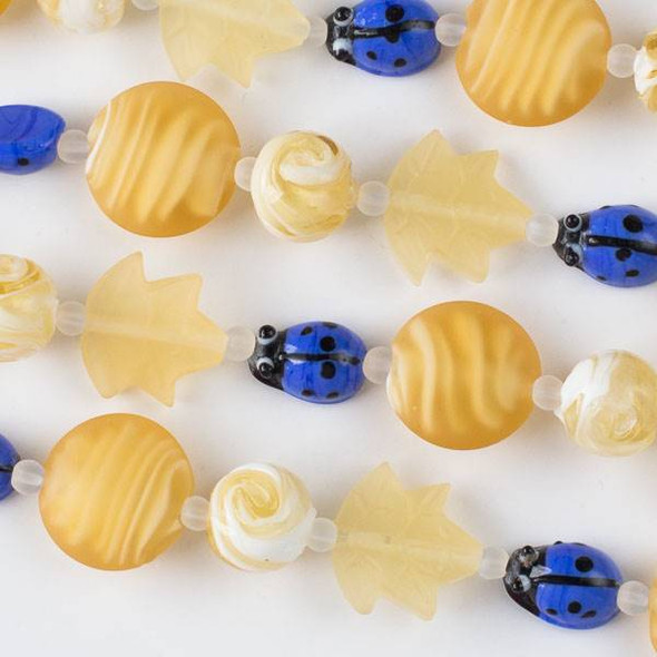 Handmade Lampwork Glass Nature Collection - Blue Ladybug and Matte Honey Yellow Mix with Leaf, Coin, and Round