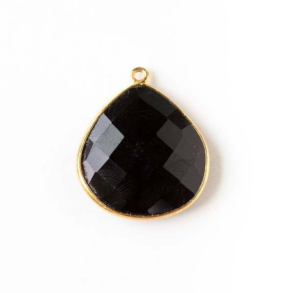 Onyx approximately 21x24mm Almond Drop with a Gold Plated Brass Bezel