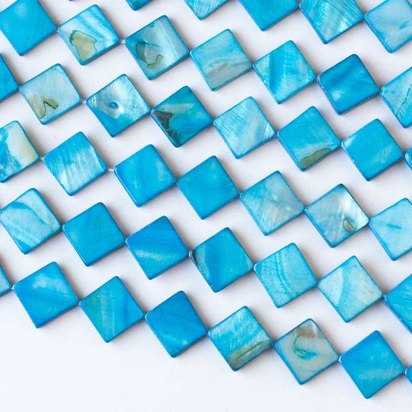 Dyed Shell 12mm Blue Diagonally Drilled Square Beads - 16 inch strand