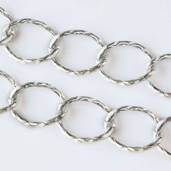 Silver Aluminum Chain with 15x20mm Open Twisted Textured Oval Links - chainK14307s - 1 foot