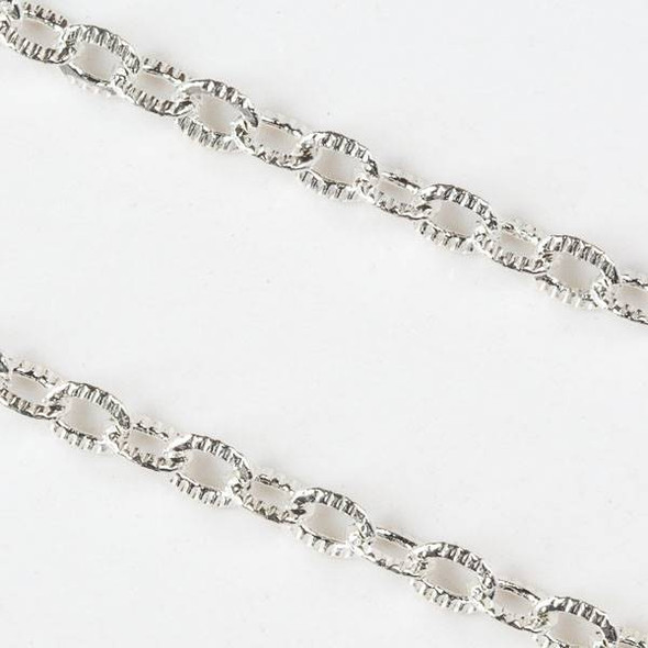 Silver Brass Chain with 4x5mm Textured Soldered Oval Links - chain280SFQWs-sp - 25 yard spool