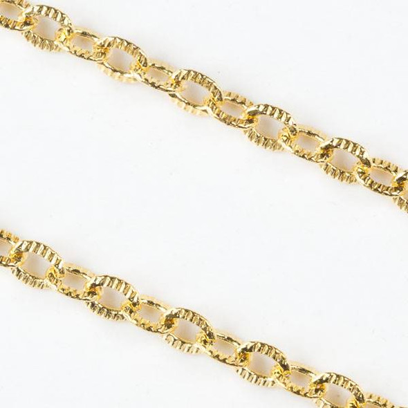 Gold Brass Chain with 4x5mm Textured Soldered Oval Links - chain280SFQWg-sp - 25 yard spool