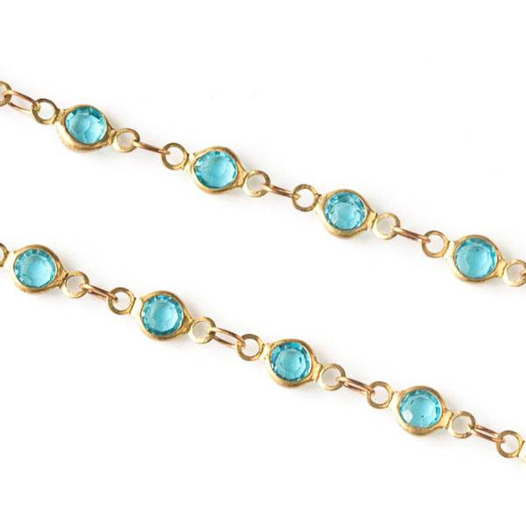 Brass Chain with 2.5x3.5mm Small Oval Links alternating with 4.5x9mm Aqua Crystal Coin Links - chain1323clrvb-1m - 1 meter
