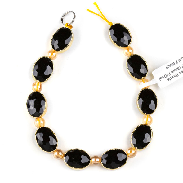 Crystal 12x16mm Opaque Black Faceted Oval Beads with Golden Foil Edges - 8 inch strand