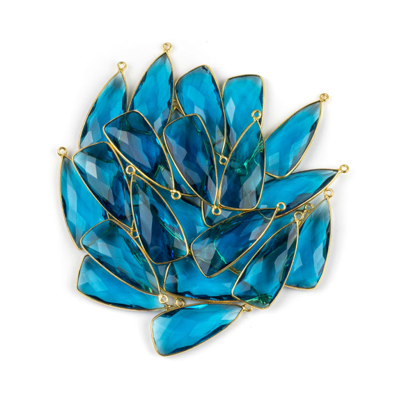 London Blue Quartz 14x34mm Faceted Irregular Triangle Drop with a Gold Plated Brass Bezel and Loop - 1 per bag