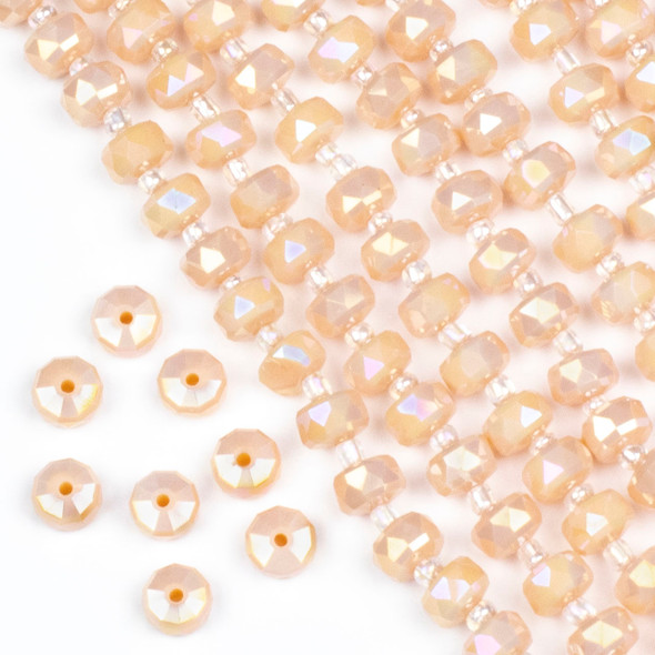 Crystal 5x8mm Opaque Pearlescent Peach Faceted Heishi Beads with an AB finish - 16 inch strand