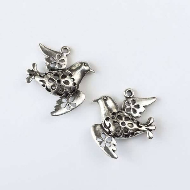 Silver Pewter 32x35mm Flying Bird Charm with Cut Out Flowers - 2 per bag